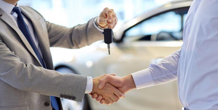 car keys being passed