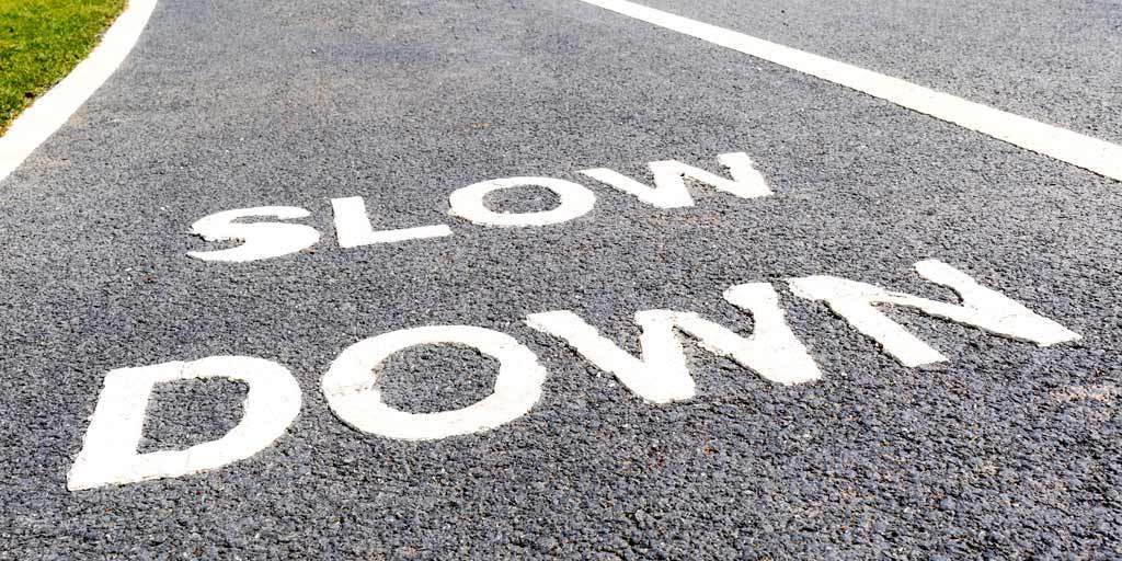Slow down road marking