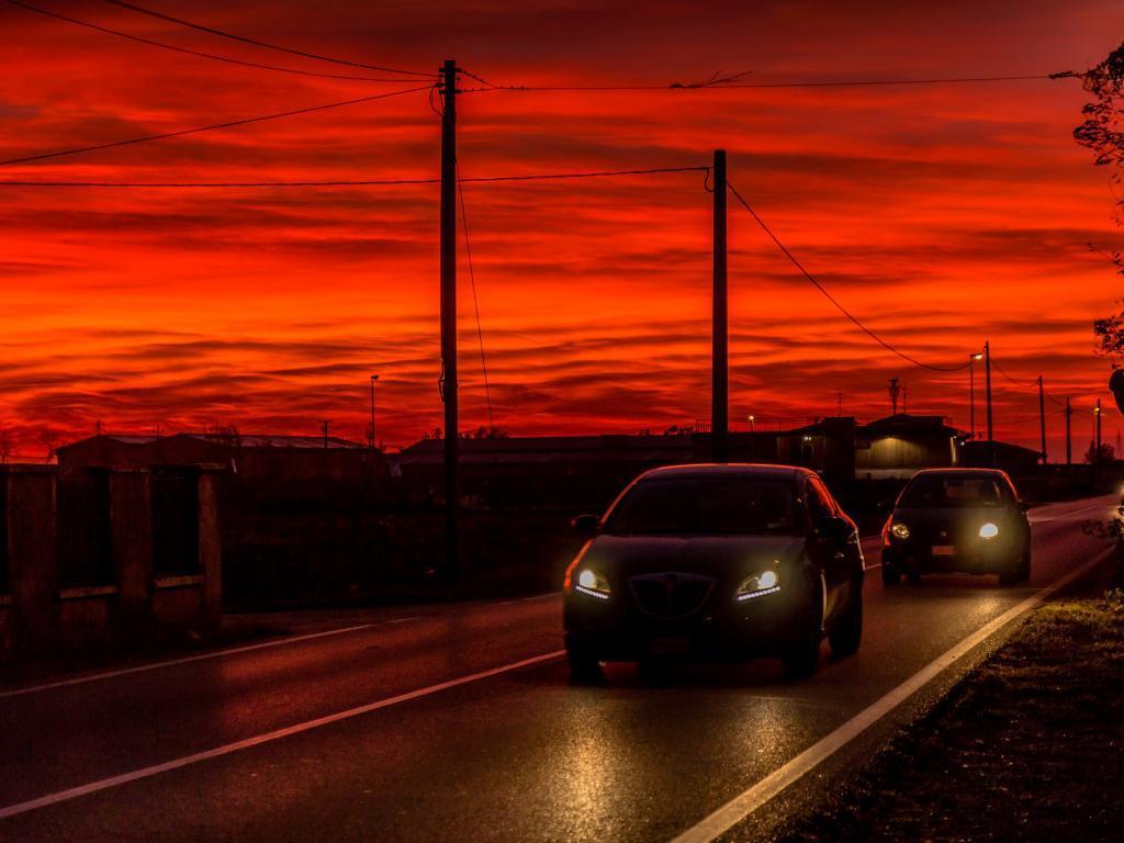 cars on road dusk