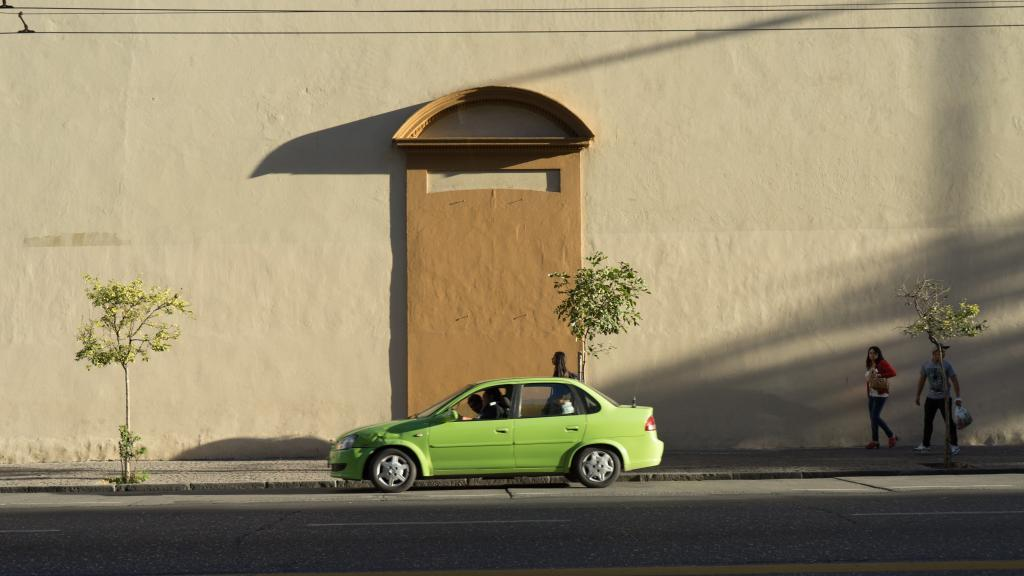 Green Car By Wall